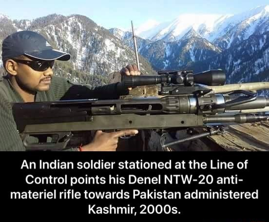 An Indian soldier stationed at the Line of Control points his Denel NTW 20 anti materiel rifle towards Pakistan administered Kashmir, 2000s. An Indian soldier stationed at the Line of Control points his Denel NTW 20 anti materiel rifle towards Pakistan administered Kashmir, 2000s meme