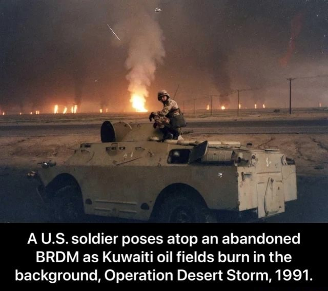 AU.S. soldier poses atop an abandoned BRDM as Kuwaiti oil fields burn in the background, Operation Desert Storm, 1991. A U.S. soldier poses atop an abandoned BRDM as Kuwaiti oil fields burn in the background, Operation Desert Storm, 1991 memes