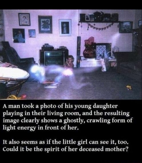 Aman took a photo of his young daughter playing in their living room, and the resulting image clearly shows a ghostly, crawling form of light energy in front of her. It also seems as if the little girl can see it, too. Could it be the spirit of her deceased mother meme