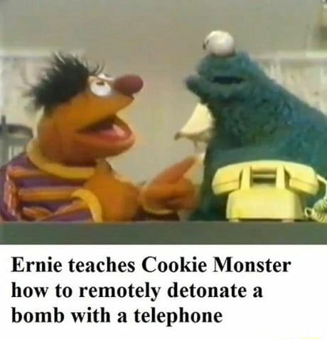Ernie teaches Cookie Monster how to remotely detonate a bomb with a telephone memes