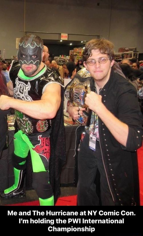 Me and The Hurricane at NY Comic Con. I'm holding the PWI International Championship Me and The Hurricane at NY Comic Con. I'm holding the PWI International Championship meme