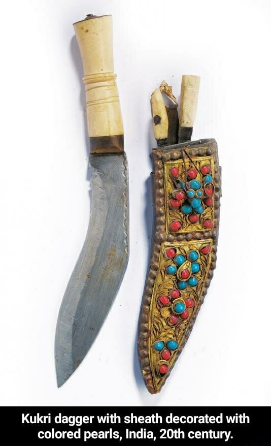 Kukri dagger with sheath decorated wi colored pearls, India, 20th century. Kukri dagger with sheath decorated with colored pearls, India, 20th century memes