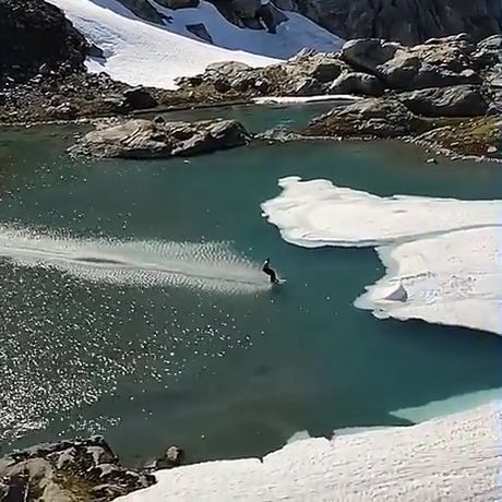 Skiing through the lake - Funny Videos - funvizeo.com - winter,snowboarding,funny,lake