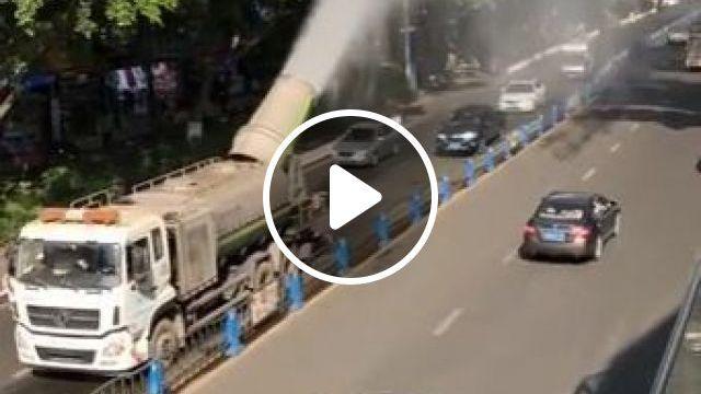 Water spray truck creates rainbow