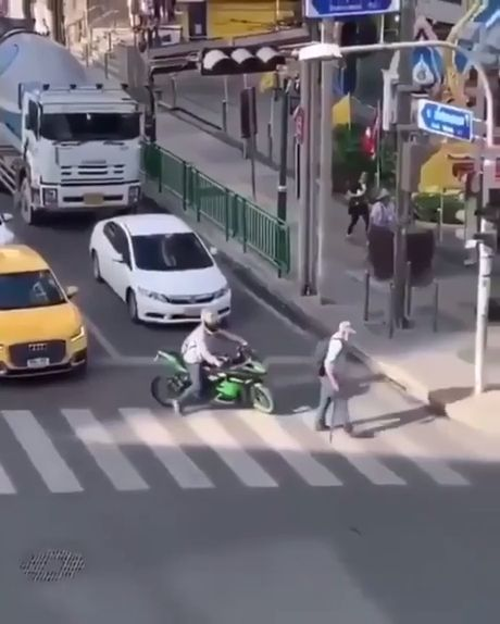Biker Blocks Traffic To Help Someone Crossing The Street - Funny Videos - funvizeo.com - funny,biker,crossing the street