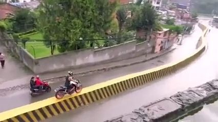 Glad that he didn't fall - Funny Videos - funvizeo.com - motorbike,driving a motorbike,danger,high road,funny,balance a motorcycle