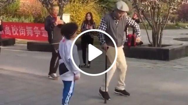 Grandpa dancing with his grandson